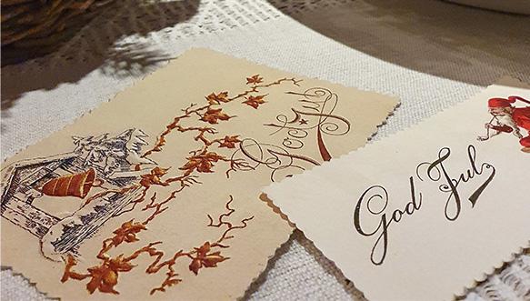 Hyvän Joulun toivotus kirjoitettuna paperille God Jul